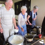 Ian, Pauline and Jenny serving lunch to patients