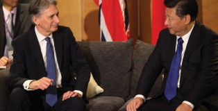 Strictly business: Foreign Secretary Philip Hammond in cordial conversation with the Chinese President; human rights were not on the official agenda