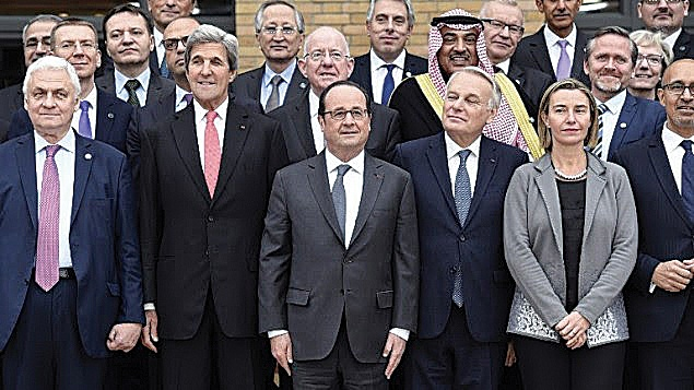 President Hollande, centre, fronts the Paris 'peace' conference with former US Secretary of State John Kerry, centre left