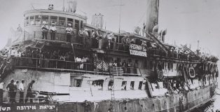 The Exodus, a ship packed with Jewish refugees and holocaust survivors arriving in Haifa, Israel