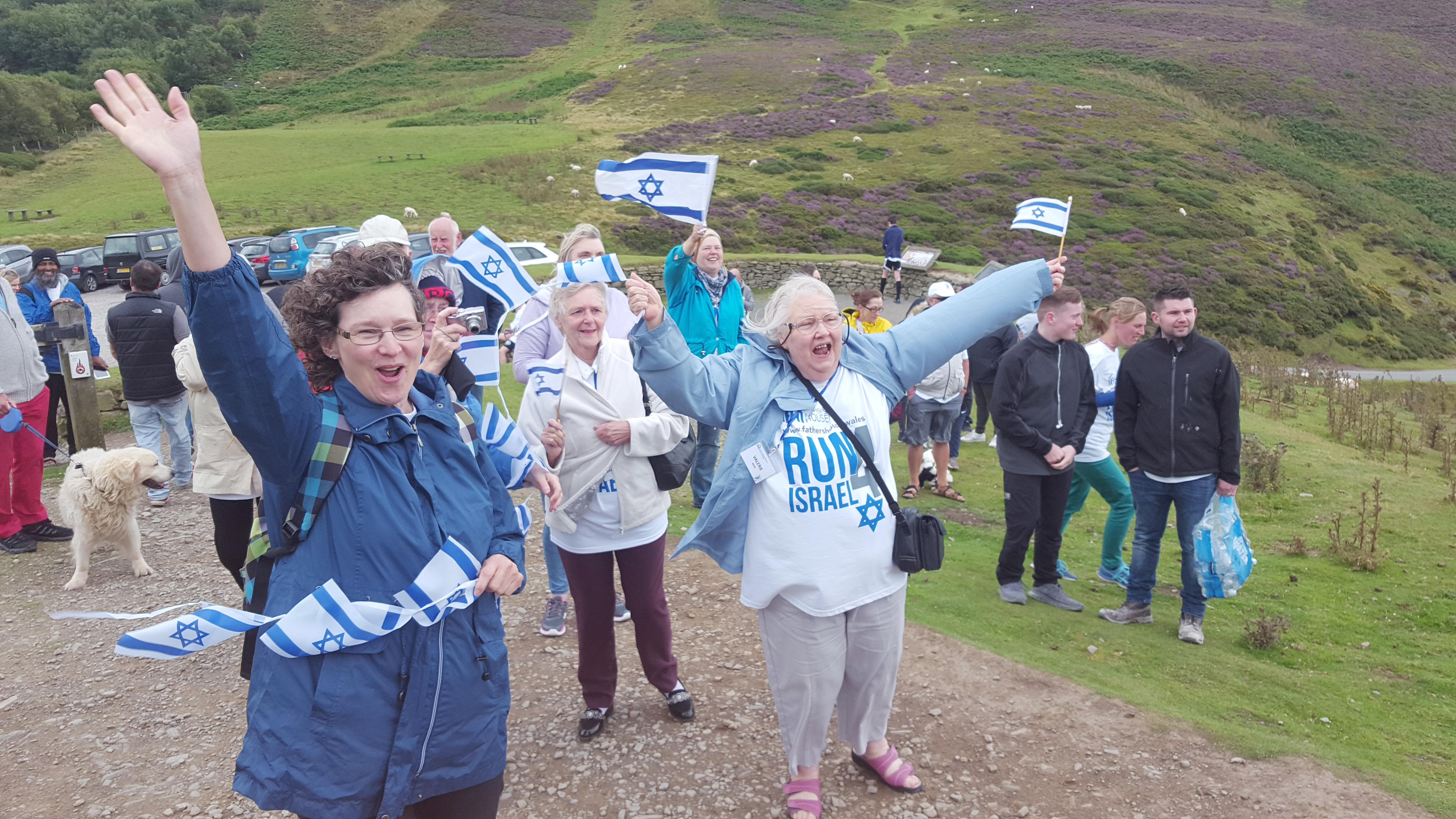 In an event organised by the Father's House Sabbath congregation at Shotton, Deeside, cheerleaders greet 80 intrepid runners as they complete 8km along the Clwydian range in North Wales to demonstrate Christian support for Israel