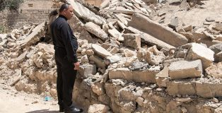 Father Thabet, a church leader in Karamles, surveys the rubble  (Credit: Open Doors)