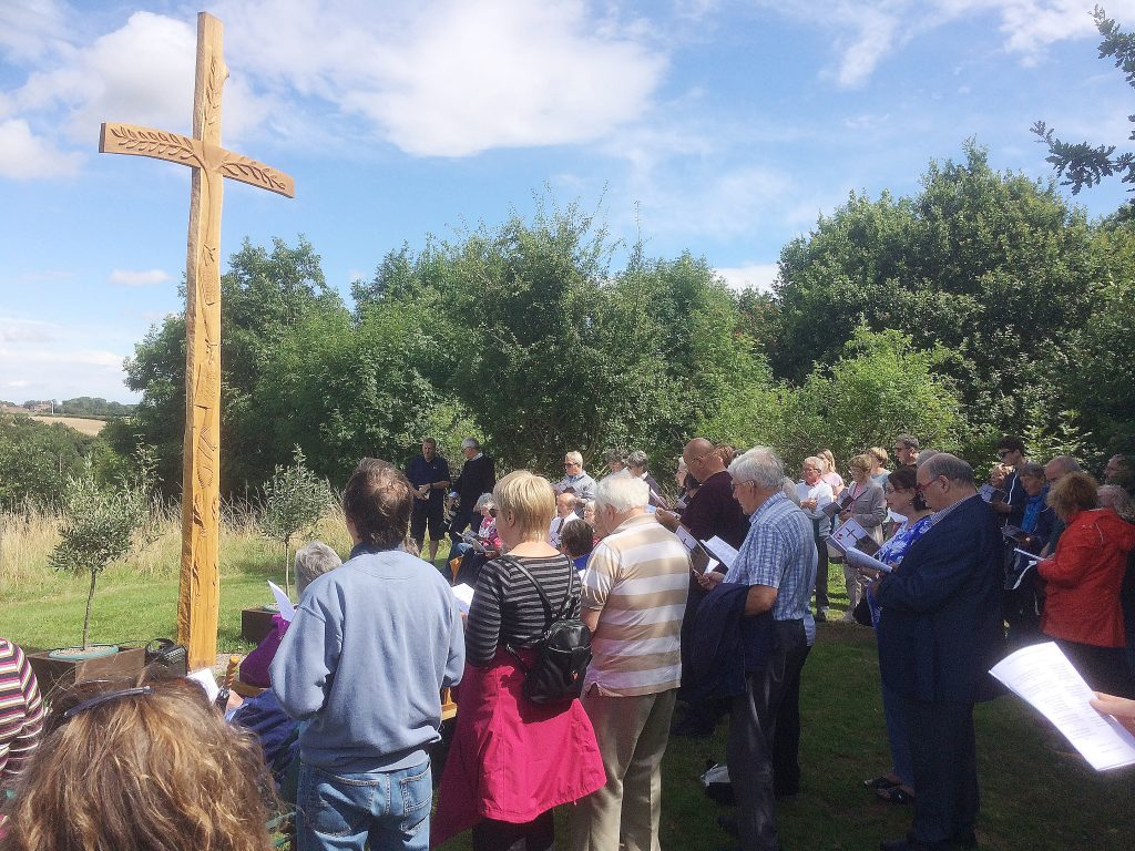 Worship at the cross's dedication