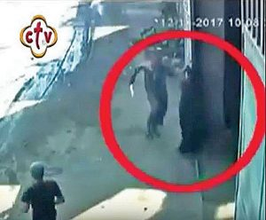 Captured by security camera before other citizens caught him, Bishop Samaan Shehata's assailant arrives at a warehouse in pursuit of the injured Shehata, weapon in hand Credit: Morning Star News