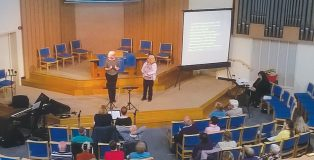 Combatting isolation: conference visitors learned about and shared deaf people's needs