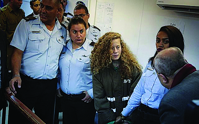 Palestinian teen Ahed Tamimi is being held in custody after assaulting two Israeli soldiers