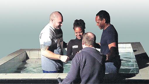 Brigitta Jaffar is baptised at church by Pastor Rohan Andrew (right)