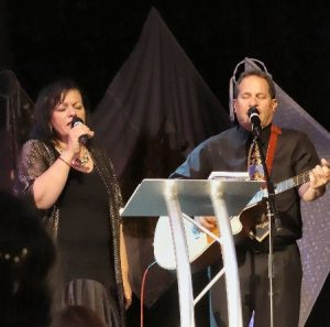 Barry and Batya Segal singing at a Christian and Jewish celebration event in Dorset