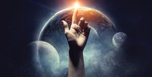 Human hand pointing with finger as symbol of creation. Elements of this image are furnished by NASA