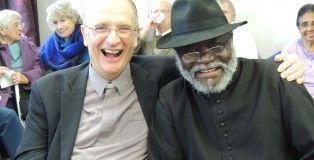 Vicar Stephen Bowen with Reigate's Archdeacon Danny Kajumba at Stephen's retirement service