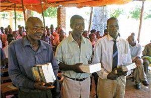 Mozambiquan pastors receiving Bibles
