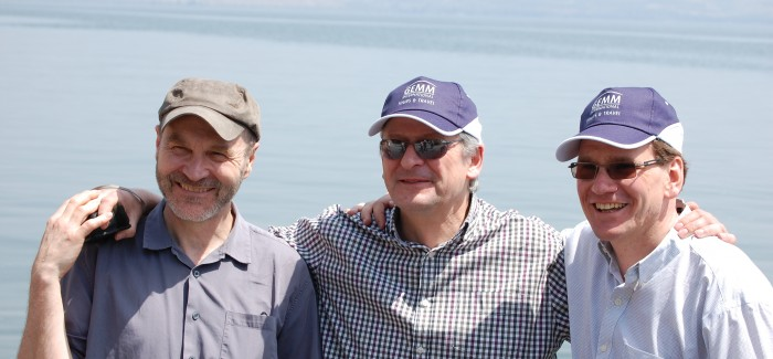 Roger Greene, left, with fellow directors Simon Thane (centre) and Alastair Mitchell-Baker on the shore of the Church of St Peter's Primacy, purportedly where Jesus told his disciples to let down their nets on the othe4r side