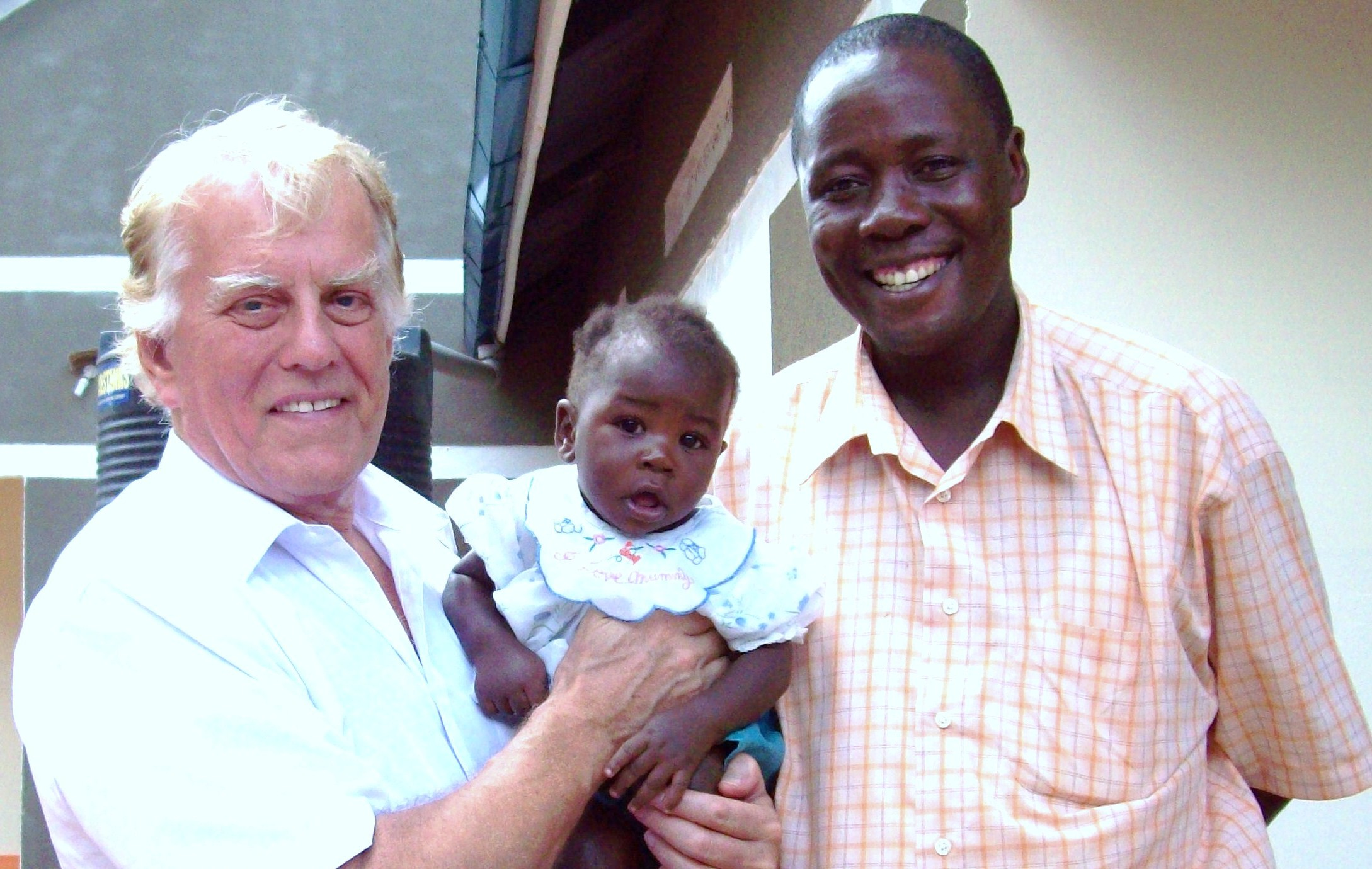 Dr Tony Sargent and former theological student Gabriel Kijjambu from Uganda and Gabriel's child