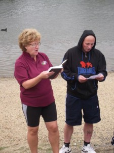 Mark shivering at his baptism with Rev Kath Jones in Southwater Park