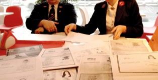 Swamped by paperwork: two of Ukraine's highest ranking Salvation Army officers have to process a pile of identity documents so that refugees can receive food parcels and clothes