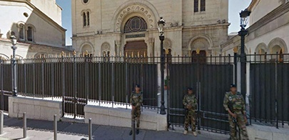 Armed guards standing outside Marseille Central Synagogue