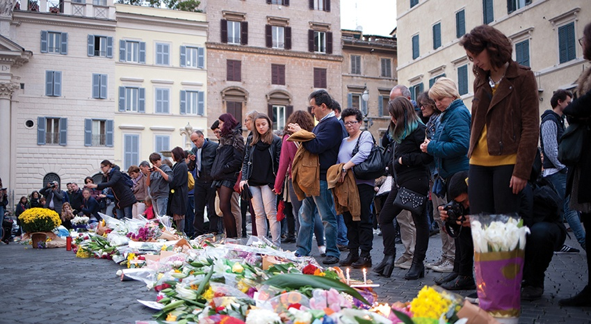 Residents lay flowers at the scene of one of the recent terrorist massacres in central Paris ...but where are the flowers for massacred Syrian Christian children?