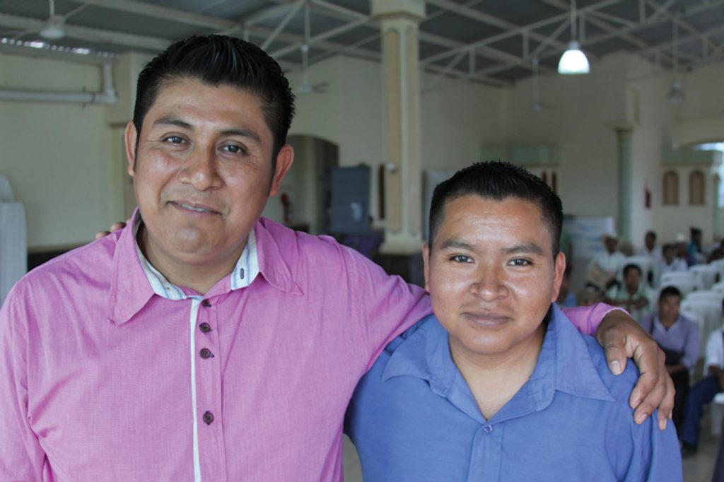 Thrown out of his village: Casto (right) with the pastor of his church