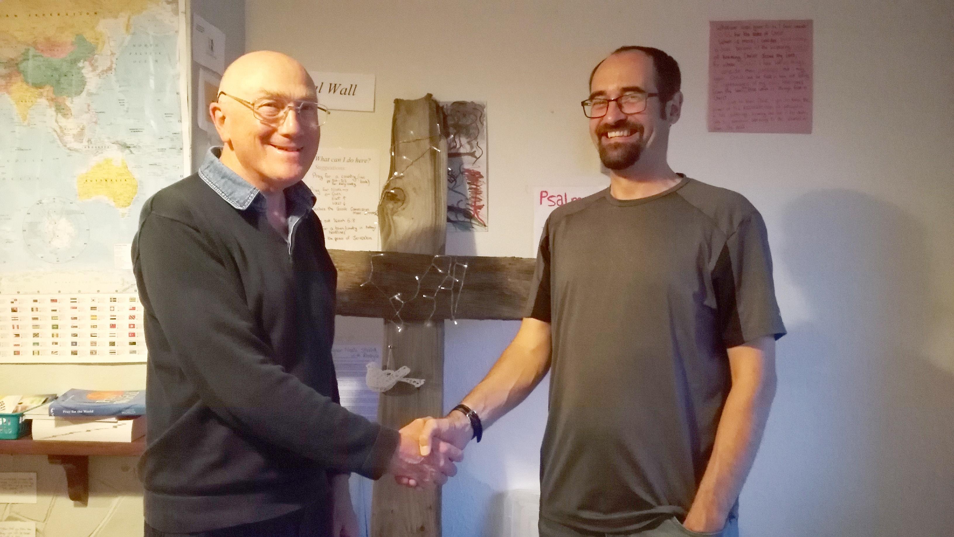Pastor John France (left) has handed over to Ben Leney