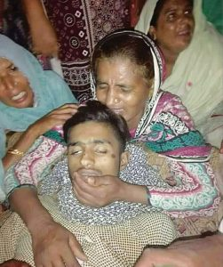 Arslan's body cradled by his distraught mother