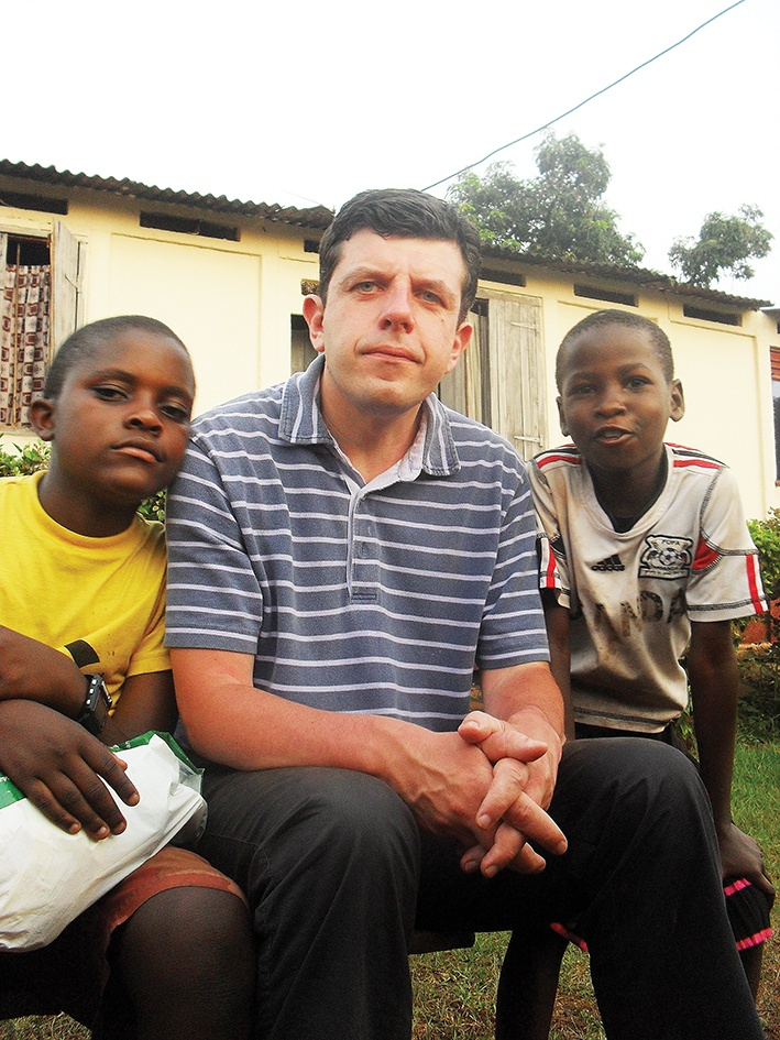 Author Daniel Harrison with friends in Uganda, where his ministry helps fund schools and church buildings