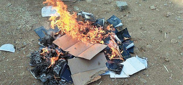 Elderly Gideons' Bibles burnt