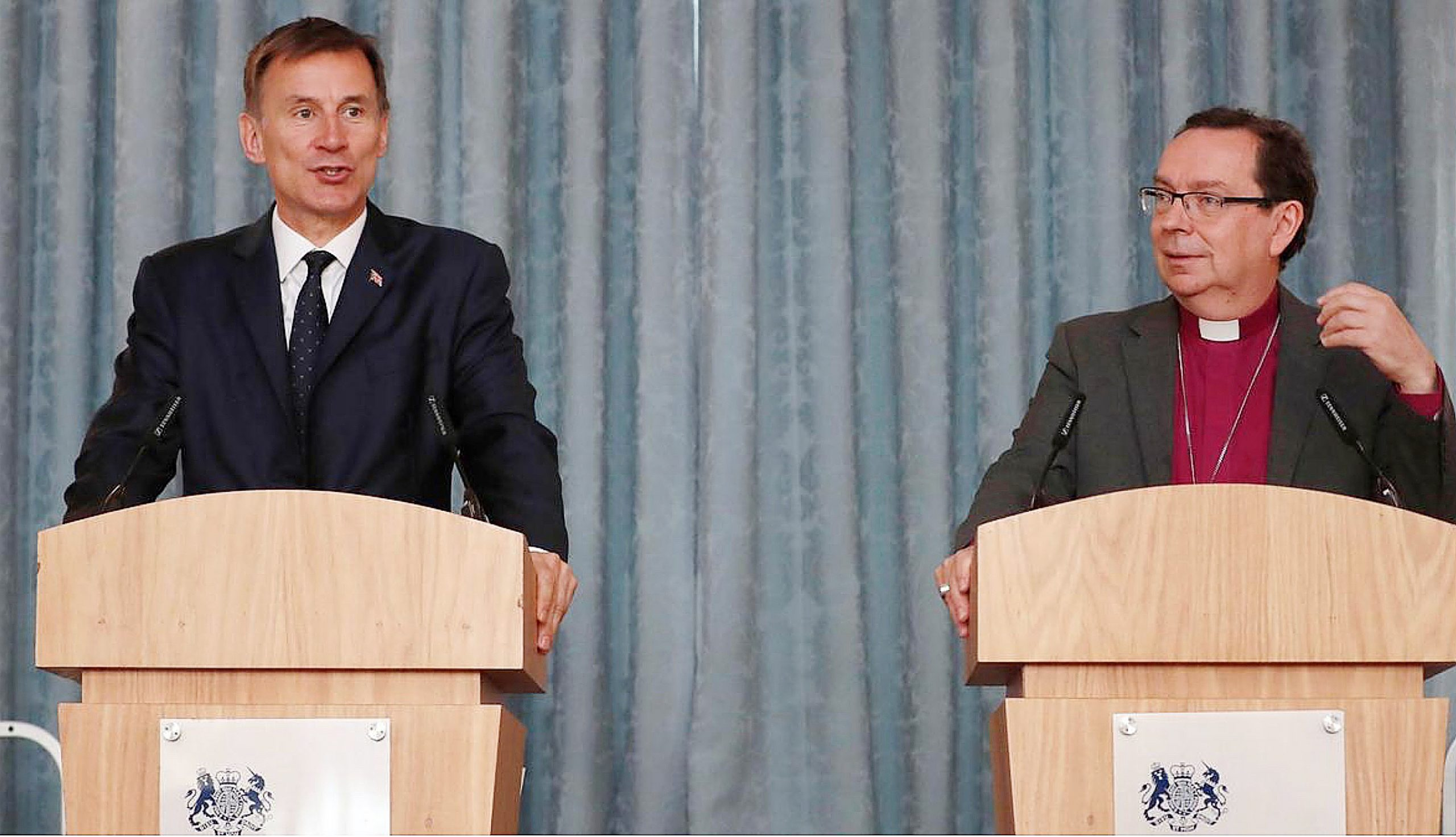 Jeremy Hunt shares a podium with the bishop