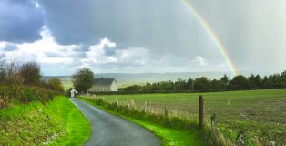 A rainbow of hope hovers over a remote Welsh chapel