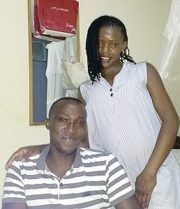 Peter Mulinge and his pregnant wife, Lucy