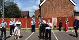 Salvation Army play hymns in the car park