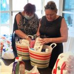Julia Muir and Linda Smith packing