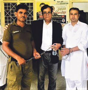 Asif Pervaiz (right) with lawyer Saiful Malook (centre) at prison