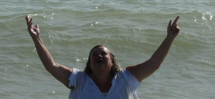 Beach baptism joy