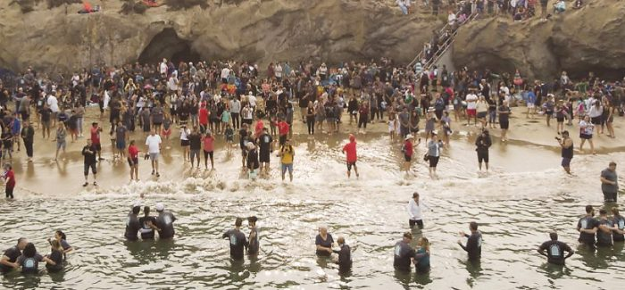 """A California church baptises 1,000 During the battle to worship freely, California could be heading for revival. Calvary Chapel Church baptised nearly 1,000 people in the sea at Newport Beach – over three times their normal number – on 12 September. Church Director Gina Gleason said: """"California may be experiencing a spiritual revival."""" Pictures: Calvary Chapel Church Calvary Chapel Church saw nearly 1,000 people publicly declare their new faith in Christ"""
