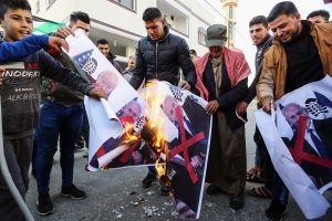 Palestinians burn pictures of Trump