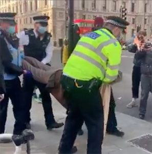 A phone video showed police manhandling the old lady