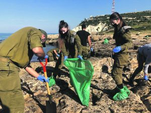 IDF soldiers help with the clear up