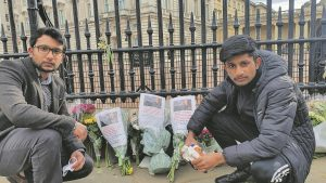 Two of the Bhinder family's sons outside Buckingham Palace