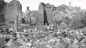 Soldiers surveying the skulls of victims in an Armenian village