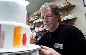 Masterpiece Cakeshop owner Jack Phillips decorates a cake